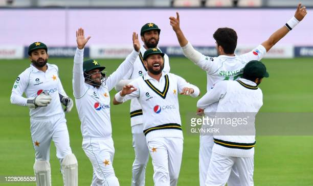Pakistan's Shaheen Afridi celebrates with teammates after taking the wicket of England's Rory Burns during play on the fourth day of the second Test...