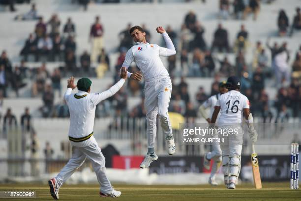 TOPSHOT Pakistan's Shaheen Shah Afridi celebrates after dismissing Sri Lanka's Dimuth Karunaratne during the first day of the first Test cricket...