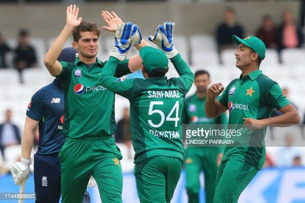 Pakistan's Shaheen Shah Afridi celebrates with Pakistan's Sarfaraz Ahmed after taking the wicket of England's Eoin Morgan during the fifth One Day...