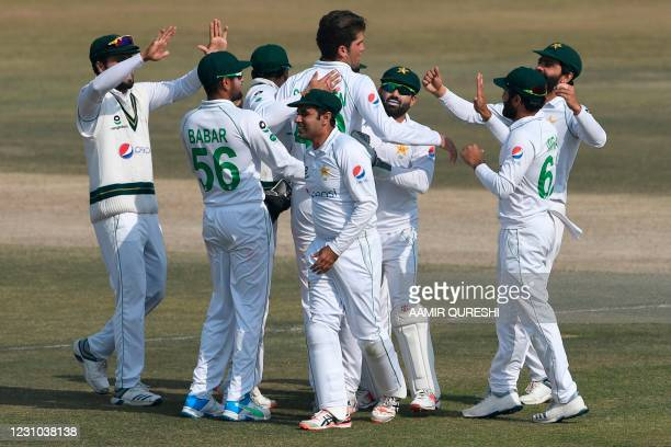Pakistan's Shaheen Shah Afridi celebrates with teammates after taking the wicket of South Africa's Temba Bavuma during the fifth and final day of the...