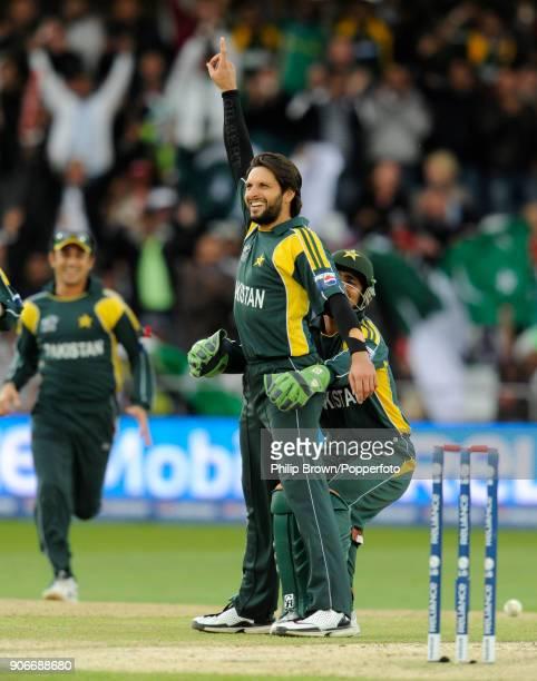 Pakistan's Shahid Afridi celebrates with teammate Kamran Akmal after dismissing South Africa's Hershelle Gibbs during the ICC World Twenty20 Semi...
