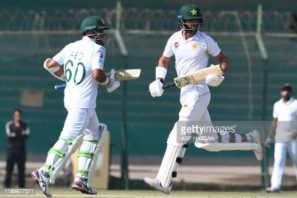 Pakistan's Shan Masood and Abid Ali make runs during the third day of the second Test cricket match between Pakistan and Sri Lanka at the National...