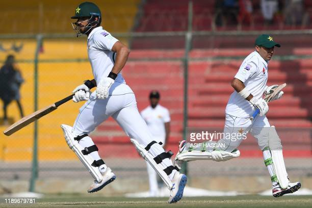 Pakistan's Shan Masood and Abid Ali run between the wicket during the third day of the second Test cricket match between Pakistan and Sri Lanka at...