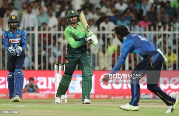 Pakistan's Shoaib Malik bats during the fourth one day international cricket match between Sri Lanka and Pakistan at Sharjah Cricket Stadium in...