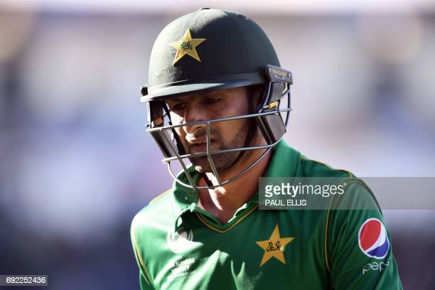 Pakistan's Shoaib Malik leaves the field after losing his wicket during the ICC Champions trophy match between India and Pakistan at Edgbaston in...