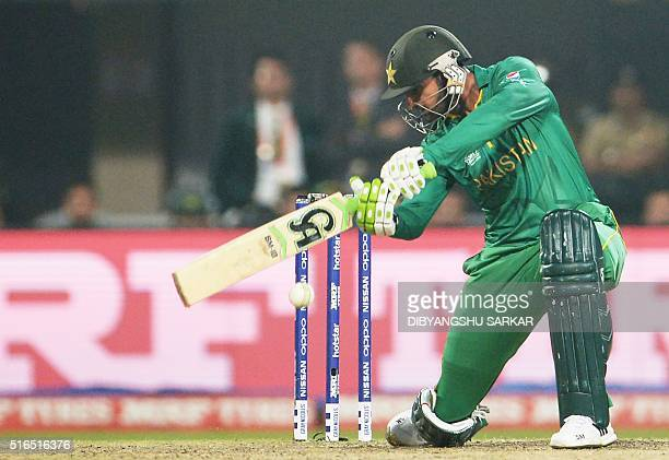 Pakistan's Shoaib Malik plays a shot during the World T20 cricket tournament match between India and Pakistan at The Eden Gardens Cricket Stadium in...