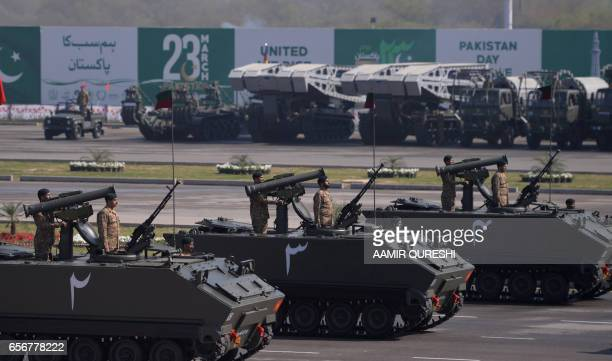 Pakistan's tank crews steer their vehicles during a Pakistan Day military parade in Islamabad on March 23 2017 Pakistan National Day commemorates the...
