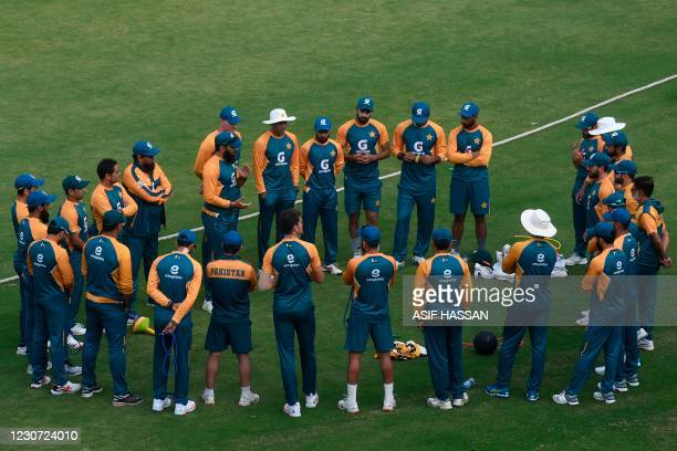 Pakistan's team members attend a practice session at the National Stadiumin Karachi on January 22 ahead of their first cricket test match against...