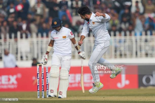 Pakistan's Usman Shinwari celebrates after dismissing Sri Lanka's Kusal Mendis during the first day of the first Test cricket match between Pakistan...