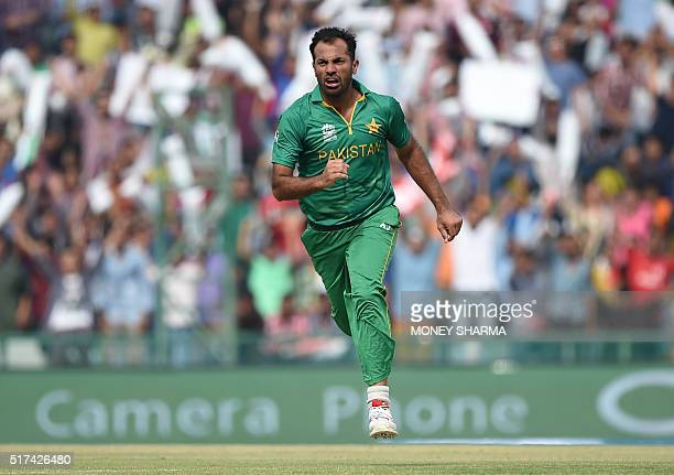 Pakistan's Wahab Riaz celebrates after his dismissal of Australia's David Warner during the World T20 cricket tournament match between Australia and...