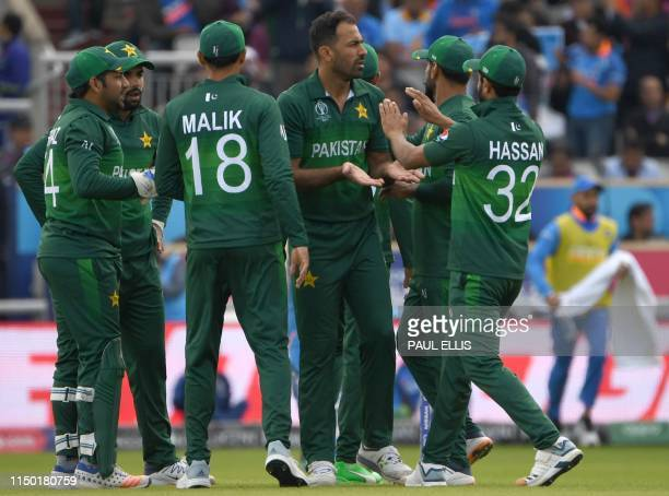 Pakistan's Wahab Riaz celebrates with teammates after the dismissal of India's KL Rahul during the 2019 Cricket World Cup group stage match between...