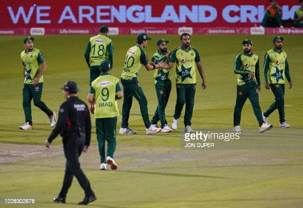 Pakistan's Wahab Riaz is congratulated for the dismissal of England's Moeen Ali during the international Twenty20 cricket match between England and...