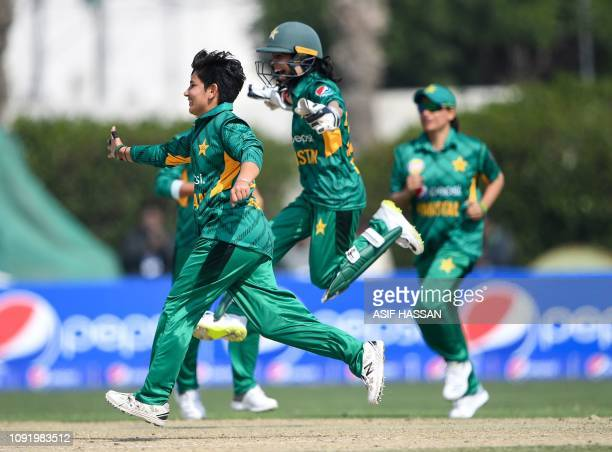 Pakistan's wicketkeeper Sidra Nawaz celebrates with teammates after stumpping out West Indies cricketer Kycia Knight during the second Twenty20 match...