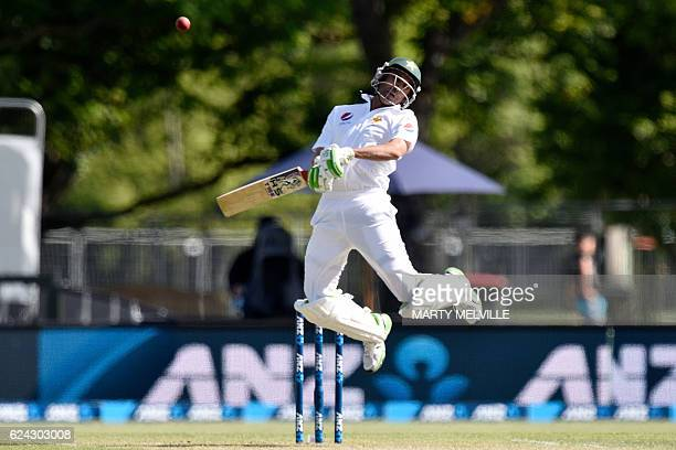 TOPSHOT Pakistan's Younis Khan hits the ball straight to New Zealand's keeper BJ Watling and is caught during day three of the first cricket Test...