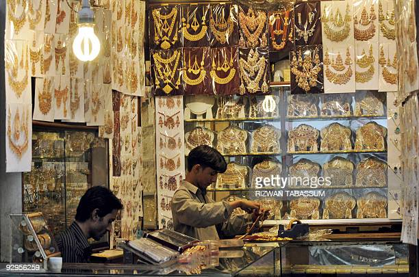 PakistansocietyeconomyweddingsFOCUS by Hasan Mansoor Pakistani shopkeepers arrange jewellery as they wait for customers at a shop in Karachi on...
