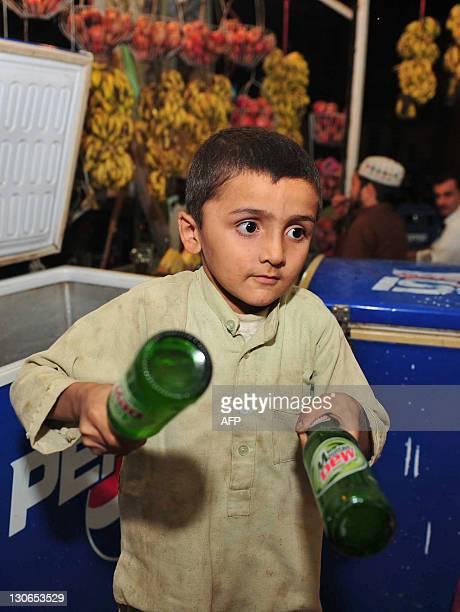 PakistanunrestchildrenpovertyFEATURE by Khurram Shahzad In this photograph taken on October 27 2011 sevenyearold Pakistani boy Zabita Khan works at a...