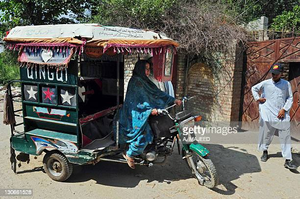 PakistanunrestchildrenpovertyFEATURE by Khurram Shahzad In this photograph taken on September 29 11yearold Pakistani girl Wajiha drives a threewheel...