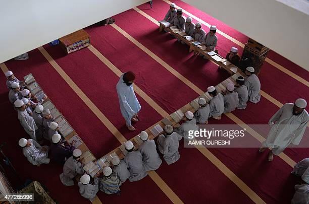 PakistanUnrestEducationReligion FEATURE by Gohar ABBAS This photograph taken on May 5 2015 shows Pakistani teachers of a madrassa or Islamic school...