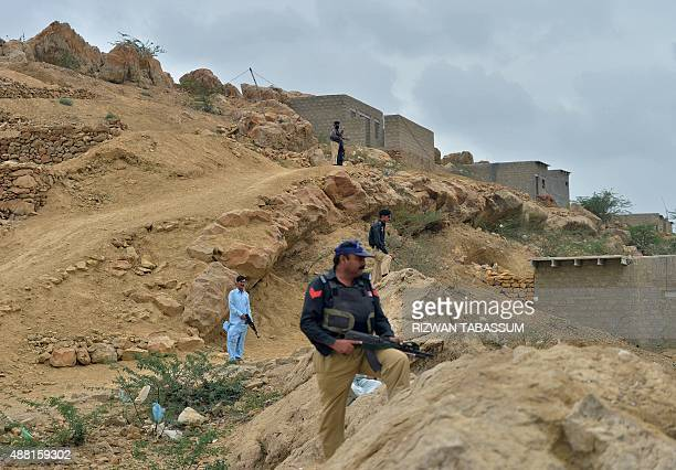 PakistanunrestKarachiTaliban FEATURE by Guillaume Lavallee This photograph taken on August 21 2015 shows Pakistani policemen taking a position at the...