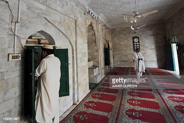 PakistanunrestreligionFOCUS by Sajjad Tarakzai In this photograph taken on December 7 a Pakistani Shiite Muslim announces the azan the call for...