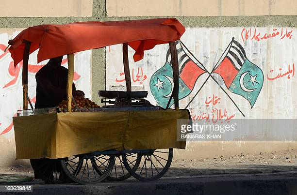 WITH PakistanunrestsouthwestLeJ focus by Khurram Shahzad This photograph taken on March 5 shows a Pakistani vendor waiting for customers as he stands...