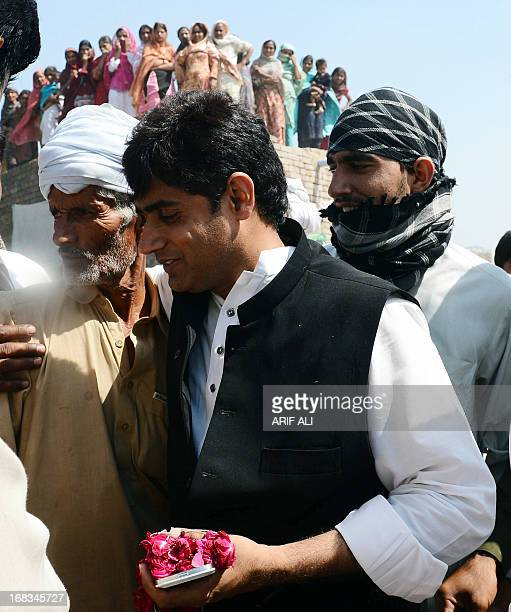 PakistanunrestvotecandidateHaq by Issam Ahmed In this photograph taken on May 8 2013 AbrarulHaq a candidate for the national assembly for Imran...