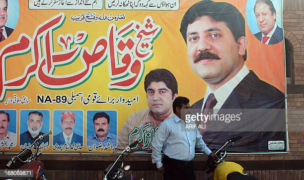 PakistanunrestvotesectarianFOCUS by Waqar Hussain In this photograph taken on April 1 A Pakistani man stands beside an electoral poster of former...