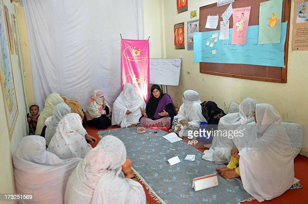 PakistanunrestwomensocietyFEATURE by Khurram SHAHZAD In this photograph taken on June 20 2013 Tabbassum Adnan head of the women jirga spaeks in Saidu...