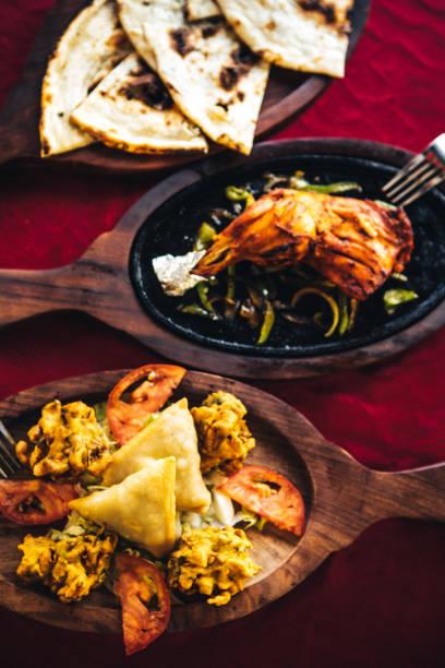 Pakora, bhaji, samosa, chicken tandoori and naan bread. North Indian food