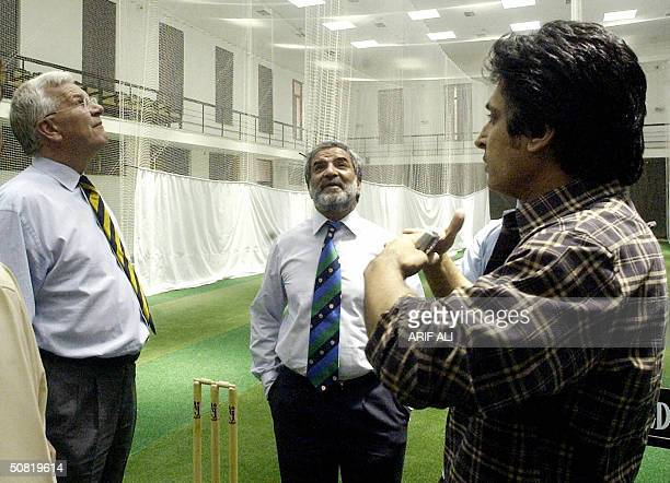 Paksitan Cricket Board Chief Executive Ramiz Raja gestures as he speaks with Chief Executive of the International Cricket Council Malcolm Speed and...