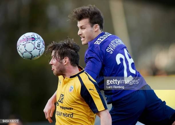 Pal Alexander Kirkevold of Hobro IK and Erik Sviatchenko of FC Midtjylland compete for the ball during the Danish DBU Pokalen Cup quarterfinal match...