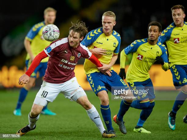 Pal Alexander Kirkevold of Hobro IK and Hjötur Hermannsson of Brondby IF compete for the ball during the Danish Alka Superliga match between Brondby...