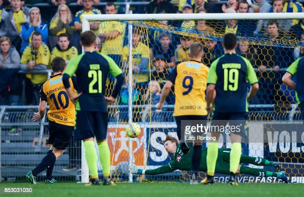 Pal Alexander Kirkevold of Hobro IK scores the 10 goal against Goalkeeper Frederik Ronnow of Brondby IF during the Danish Alka Superliga match...