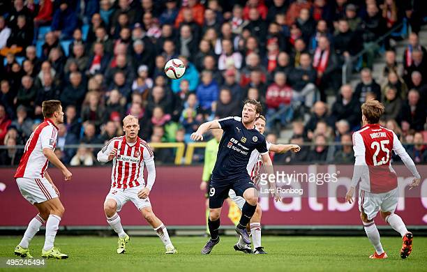 Pal Alexander Kirkevold of Hobro IK surrounded by four AaB Aalborg players during the Danish Alka Superliga match between AaB Aalborg and Hobro IK at...