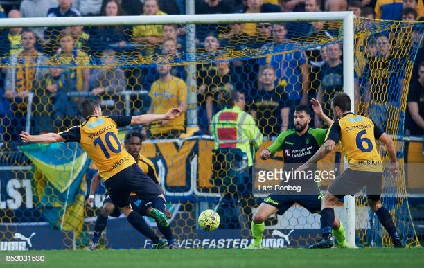 Pal Alexander Kirkevold of Hobro IK try to score but his team mate Quincy Antipas accidental saves the ball on the goalline during the Danish Alka...