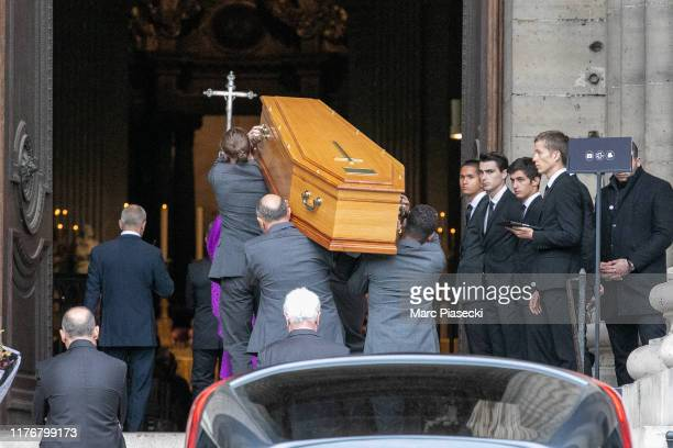 Pal bearers carry the coffin during Peter Lindbergh's funerals at Eglise Saint-Sulpice on September 24, 2019 in Paris, France.