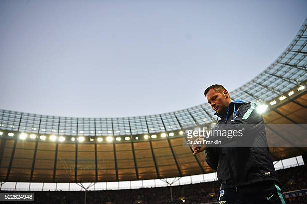 Pal Dardai head coach of Berlin checks his watch during the DFB Cup semi final match between Hertha BSC Berlin and Borussia Dortmund at the Olympic...