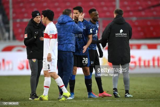 Pal Dardai, Head Coach of Hertha BSC with Sami Khedira of Hertha BSC following the Bundesliga match between VfB Stuttgart and Hertha BSC at...