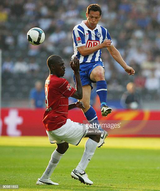 Pal Dardai of Berlin and Mohamadou Idrissou of Freiburg battle for the ball during the Bundesliga match between Hertha BSC Berlin and SC Freiburg at...
