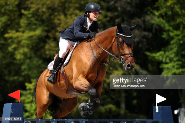 Pal Flam of Norway riding Skjerabergs Larkin competes during Day 3 of the Longines FEI Jumping European Championship speed competition against the...