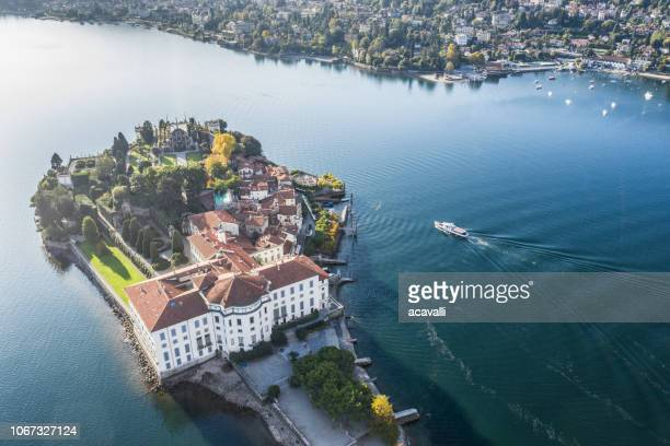 palace and garden on an island on a lake - stresa stock pictures, royalty-free photos & images