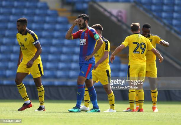 Palace defender James Tomkins holds his head after his mistake had led to the opening goal for Oxford at Kassam Stadium on July 21 2018 in Oxford...