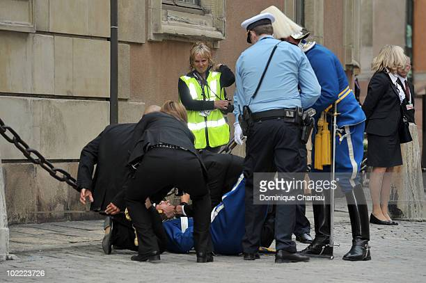 A palace guards is helped after fainting by colleagues prior to the wedding of Crown Princess Victoria of Sweden and Daniel Westling on June 19 2010...