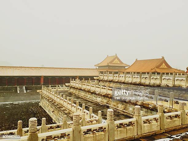 Palace In Forbidden City Against Sky During Foggy Weather