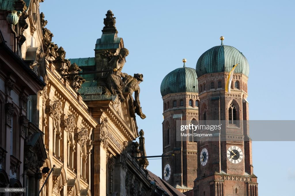 Palace in Kardinal-Faulhaber Street 10 and Frauenkirche Cathedral, Munich, Bavaria, Germany : Stock Photo