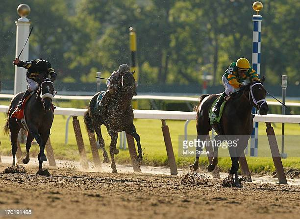 Palace Malice ridden by Jockey Mike Smith outruns the firld to win the 145th running of the Belmont Stakes at Belmont Park on June 8 2013 in Elmont...