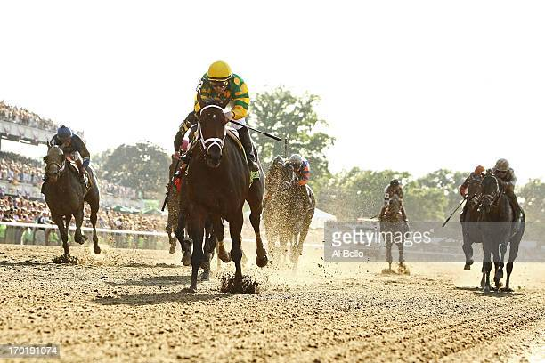 Palace Malice ridden by Mike Smith wins the 145th running of the Belmont Stakes followed by Oxbow Ridden by Gary Stevens and and Orb ridden by Joel...