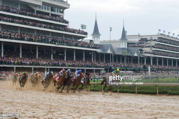 Palace Malice with Mike Smith up leads during the first turn of the 139th running of the Kentucky Derby at Churchill Downs in Louisville Kentucky on...