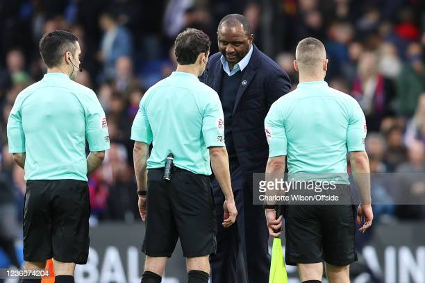 Palace manager Patrick Vieira seems to have stern words with referee Darren England after Palace are denied a last minute victory due to VAR during...