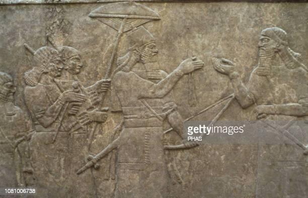 Palace of Ashshurbanipal II Nimrud Iraq King receives prisoners Upper Mesopotamia NeoAssyrian Empire 883859 BC British Museum London United Kingdom